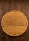 Pizzaskärbräda på trä arkivfoton