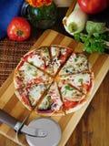 Pizzasnitt in i delar Arkivbilder
