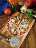 Pizzasnitt in i segment Arkivbild