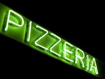 Pizzeria neon sign. Neon pizzeria sign at nigh Stock Photography