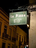 Pizzeria signboard in a european street. Royalty Free Stock Photo