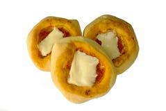 Pizzette - mini geïsoleerdev pizza's -. Stock Afbeelding