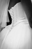 Pizzi posteriori del corsetto del vestito da sposa Immagini Stock