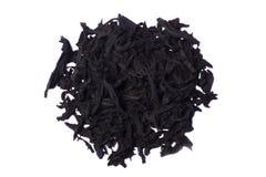 Pizzico del tè nero dell'a fogli staccabili Fotografia Stock Libera da Diritti