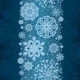 Pizzo astratto di inverno dai fiocchi di neve. Immagine Stock