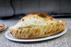 Pizzy calzone Italia Nasiąknięta karmowa restauracja Napoli Obraz Royalty Free