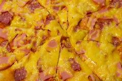 Pizzy tło - makro- strzał pepperoni pizza obraz stock