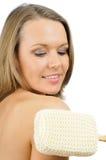Pjrtrait de la muchacha sonriente bonita que se lava el brazo imagen de archivo