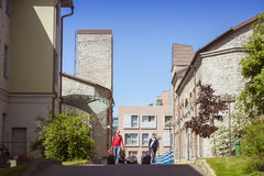 PK Ilmarine Hotel. Tourists with suitcases are on the territory of Hotel courtyard PK Ilmarine Hotel in the centre of Tallinn, Estonia Royalty Free Stock Photos