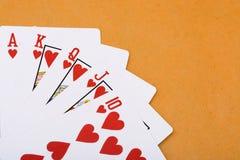 Póker real del rubor recto de los corazones rojos Foto de archivo libre de regalías