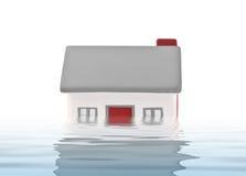 Plástico modelo da casa submerso sob a água Fotografia de Stock Royalty Free