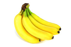 Plátano amarillo en el fondo blanco Imágenes de archivo libres de regalías