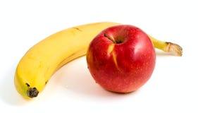 Plátano amarillo y manzana roja madura fotografía de archivo