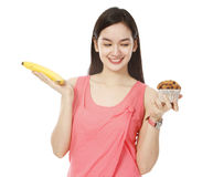 Plátano contra el mollete Fotografía de archivo libre de regalías