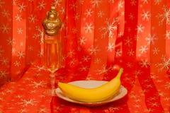 Plátano, mono y champán Foto de archivo