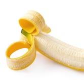 Plátano pelado en el fondo blanco Foto de archivo libre de regalías