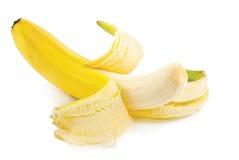 Plátano pelado mitad Imágenes de archivo libres de regalías