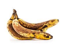 Plátano Sobre los plátanos maduros aislados en blanco con las sombras Fotografía de archivo