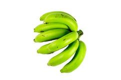 Plátano verde en el fondo blanco Imagen de archivo