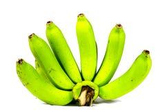 Plátano verde en el fondo blanco Foto de archivo