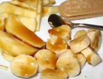 Plátano y Apple con el postre de la miel imagen de archivo libre de regalías