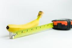 Plátano y cinta métrica Imágenes de archivo libres de regalías