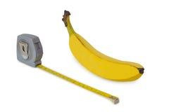 Plátano y cinta métrica Foto de archivo libre de regalías