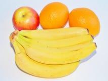 Plátano y todavía de la manzana vida anaranjada Fotografía de archivo