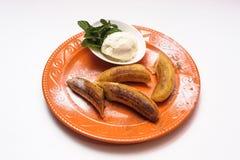 Plátanos cocidos con helado Fotografía de archivo