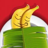 Plátanos divertidos el dormir en una placa Imagen de archivo libre de regalías