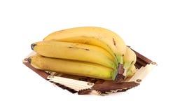 Plátanos en un florero de madera Imagen de archivo
