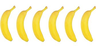 Plátanos frescos en el fondo blanco Imágenes de archivo libres de regalías
