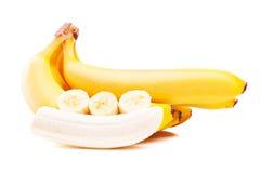 Plátanos maduros aislados en blanco Imágenes de archivo libres de regalías