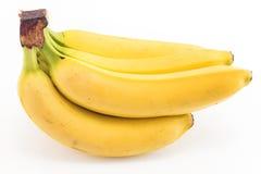 Plátanos maduros aislados en blanco Imagenes de archivo
