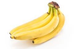Plátanos maduros en blanco Fotos de archivo libres de regalías