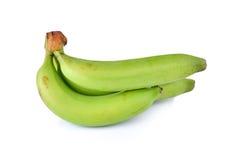 Plátanos verdes aislados en el fondo blanco Fotos de archivo libres de regalías