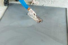 Plâtrage du ciment mélangé Photo stock