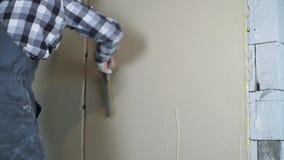 Plâtrage du processus au site de rénovation de maison avec l'espace libre clips vidéos