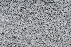 Plâtre rugueux gris, concret sur le plan rapproché de mur dans le jour ensoleillé, fond, série de texture Images stock