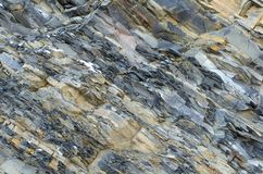 Pläterad sten Grå färg-guling kritiserar närbildbakgrund royaltyfria bilder