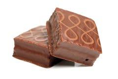 Pläterade trefaldiga nissen för chokladfuskverk Arkivfoto