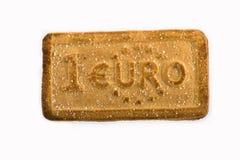 Plätzchen mit den Währungszeichen Stockfoto