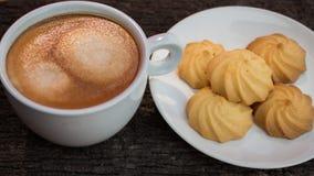 Plätzchen und Kaffee Stockbilder