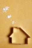Plätzchenhaus mit Mehlwolken Stockfotos