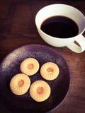 Plätzchenring mit Kaffee Lizenzfreie Stockfotos