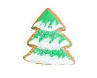 PlätzchenWeihnachtsbaum mit dem Schnee lokalisiert auf Weiß Stockfotos
