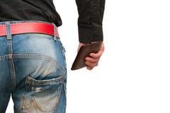 Plånbok i manliga händer Fotografering för Bildbyråer