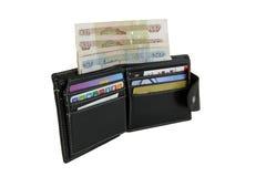 Plånbok med pengar och kontokort Royaltyfria Bilder