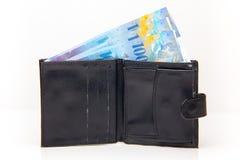 Plånbok med schweizisk franc arkivfoto