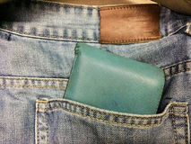 Plånbok och jean Arkivbild